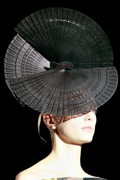 Armani Prive hat. I think it's made of fans.