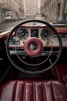 behind the wheel.. {rocking oxblood interiors way before it was even cool}