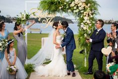 The floral arbour at this waterside ceremony even had the couple's name suspended off it! Credits in comment.