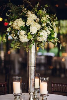 Brides.com: This Week's Best Wedding Ideas: February, 7 2014.  These tall ivory centerpieces designed by  Jackson Durham feature roses, hydrangeas, scabiosa pods, and greenery.  See more photos from Kasey and Bryce's rustic Highlands, North Carolina wedding here.