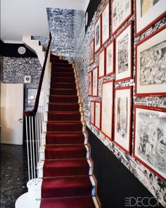 In Barnaba Fornasetti's Milan home, framed drawings by Piero are on display near the staircase.   - ELLEDecor.com