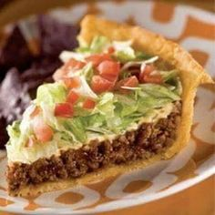 Ingredients:    2 crescent roll tubes  1 LB ground beef (or ground turkey)  1 packet of taco seasoning  1 1/2 cups grated cheddar cheese  Shredded lettuce  1 or 2 diced tomatoes depending on size  1/2 small can sliced olives if desired  Sour cream optional  sliced