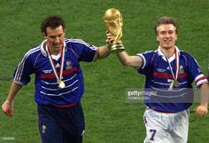 French captain Didier Deschamps (C) and Laurent Blanc (L) hold the FIFA trophy after the 1998 Soccer World Cup final between Brazil and France at Stade de France in Saint-Denis, near to Paris. France won 0-3.