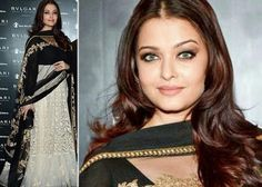 New mom Aishwarya Rai Bachchan is gunning for Vidya Balan's glory in this stunning black and white Sabyasachi anarkali at a hotel inauguration in London.