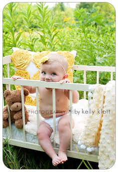 cute 6 month baby pic, I have a crib I could do this with :)