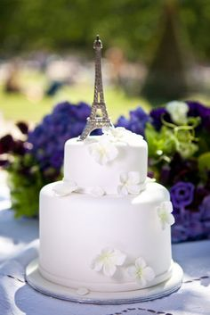 Add Chic French Details to Your Big Day: Eiffel Tower Cake Topper Photo by Fete in France via Style Me Pretty