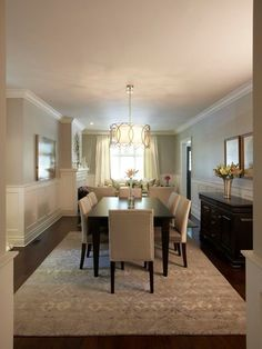 Gray Dining Room Design, white curved upholstered chairs with nailheads, black dining room table