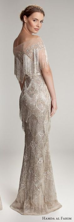 Heavily beaded mink bridal dress Love the tassles (tassles on a dress? The shape of dress is gorge)