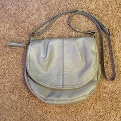 Gray Faux Leather Cross-Body Purse Gray Faux leather purse from H&M, lightly used, very spacious. A little bit of pulling on the metal magnet clasp but no one will be able to see it and it's BARELY noticeable anyway (see 4th pic). Great for casual wear. H&M Bags Crossbody Bags