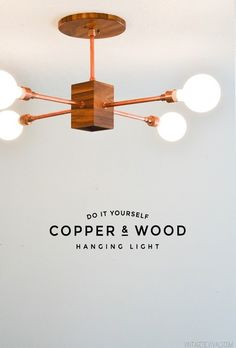 Brighten up a room with this DIY copper and wood hanging light.