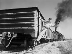 Brakeman signaling on Freight Car T&NO 47429 of the Southern Pacific Railroad Company, 1951.