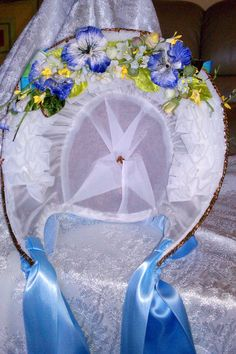 """Straw bonnet, made by Cindy Van Sluys. See the """"cheek tabs"""" or the long parts that would curl down around the cheek line, that the blue ribbons are attached to?  That is what makes this shape right vs. other reproduction bonnets.  That is absolutely essential for a good repro.  And just for good measure, the inside of her bonnet is more neatly made up than many originals I have seen."""