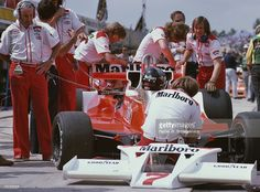 James Hunt of Great Britain sits aboard the #7 Marlboro Team McLaren McLaren M26 Ford Cosworth DFV V8 andtalks with Teddy Mayer (L) before the start of the John Player British Grand Prix on 16th July 1978 at the Brands Hatch Circuit, Fawkham, Great Britain.