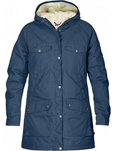 Fjallraven Greenland Winter Parka - Women's Uncle Blue Medium. A Fjallraven classic from 1972. Long parka in G-1000 Original with pile lining. Sleeves lined with nylon and filled with light padding. 2 chest pockets, 2 hand warming pockets and 2 bottom top-loading pockets. 1 inner zip pocket and 1 top-loading inner pocket with velcro closure.