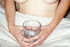 Naked and holding a glass, shot by Nate Walton. See more here: http://www.dazeddigital.com/photography/article/23922/1/an-intimate-study-of-life-and-sex-in-la