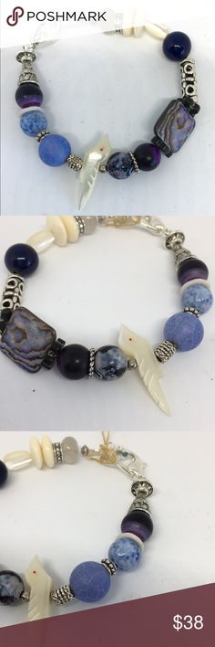 Bracelet with gemstones This delicate bracelet contains a vintage carved mother of pearl bird fetish, vintage African bead, bone, blue agate, abalone and amethyst. Unique design one of a kind. Jewelry Bracelets