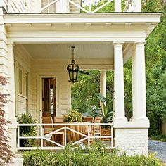 """Salvaged and Repainted - A Southern Craftsman Restoration - Southernliving. While many of the porches' floorboards and railings had rotted and needed to be replaced, the front door (including sidelights) and all of the front windows and siding needed only cosmetic maintenance. The ebony door was restained, windows reglazed, and siding repainted with Sherwin-Williams' Palais White. """"We had to pressure wash and scrape a bunch!"""" says Ashley."""