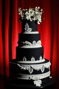 Dramatic black-and-white #wedding #cake by master confectioner Ron Ben-Israel. Layers of #vanilla and #chocolate cake with #blackberry filling; flavored with Grand Marnier and a cinnamon-cappuccino blend.