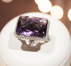 Rectangular Amethyst set in 18K white gold with Halo of Pave set diamonds and Pave diamonds halfway down the shank.
