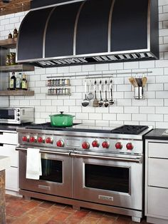 Place a shelf beside or behind the range to keep cooking oils, utensils, and spices handy. Place S hooks on the side of the range hood to hang frequently used pots and pans.