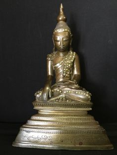 Bronze Shan Buddha from Burma, with a very long inscription and a rare stone inlay. 19th Cent.
