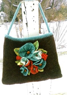 Brown and Teal Handknit Felted Purse.... handmade wet felt flowers with vintage buttons. $70.00, via Etsy.