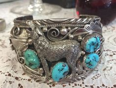 Large Henry Addaki Navajo Indian Turquoise & Sterling Silver Wolf Cuff Bracelet