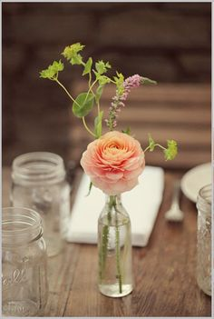 The cocktail tables will have clear bud vase with peach ranunculus, dusty miller, and blue thistles.
