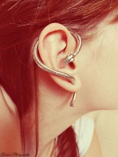 serpent ear piece for gauged ears. I love this. I may even be tempted to gauge one for this...