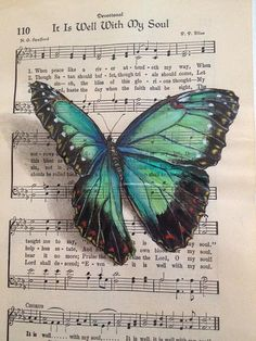 "Design Stack: Butterflies on sheet music. The angle of the butterfly and the shadow put under it make the butterfly look as though it has just ""landed"" on the sheet music."