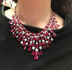 """The necklace is, as he describes clasping it behind my neck, """"a bib of rubies."""" It contains 100 rubies, weighing 160 carats, and 100 diamonds, weighing 50 carats—the precious stones took nearly five years to collect. The massive piece could fetch between $4 million and $5 million."""