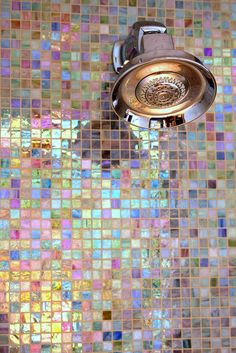 Iridescent bathroom tile. Waking up in the morning and showering with these beautiful tiles would make my day!