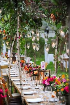 love the hanging candles and bright colored flowers