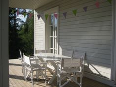 Bunting and chairs on our front porch. A perfect match just by accident.