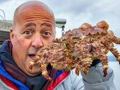 Andrew Zimmern can't hide his amusement in seeing his first box crab in Vancouver!