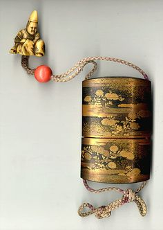 """"""" """" """" Antique Japanese Lacquer Inro and Ivory Netsuke. This 18th to 19th century """"Antique Japanese Inro"""" measures 3 and three quarters inches long by 2 and three eighths inches wide and is three..."""