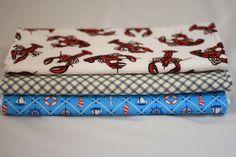 Set of three #burp cloths, one crawfish, one light blue #nautical, one navy/cream plaid    twomoellers on Etsy $15