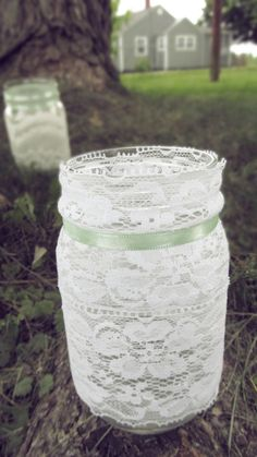 Lace Mason jars with flowers and babies breath! ♥ baby shower!! Girl: pink ribbon. Boy: blue ribbon.