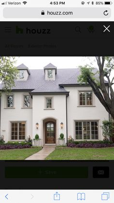 Sherwin Williams white dove siding, windows are Pavestone, window trim is Cast Stone