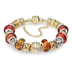 Gold and Red Solid Gold Chamilia Bracelet. <3Capri Jewelers
