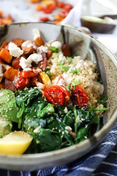 Grain Bowls with Garlicky Spinach, Roasted Sweet Potatoes, and Tahini Drizzle