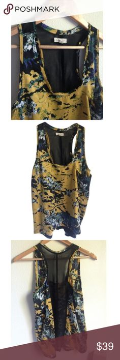 Beautiful Tank Fun tank blouse from Urban Outfitters by Silence and Noise. Size small. 100% Polyester (very soft!). See-through panel with black fabric in back. Pocket on front left. Higher in front, lower in back. Urban Outfitters Tops Tank Tops