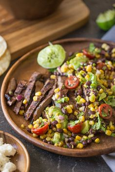 Grilled, marinated flank steak sliced thinly, wrapped in a warm corn ...