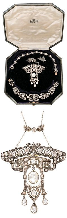 Carreras - A Belle Epoque gold, silver and diamond parure, circa 1910. Consisting of a brooch-pendant and a choker, which can be separated to form two bracelets.