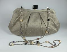 Clutch in satin and tulle with small pois, freshwater pearls, onyx, agate of Botswana and amethyst. Nickel free