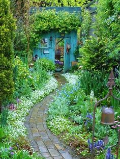 Gorgeous old brick garden path that curves and meanders to the beautiful old shed at the back