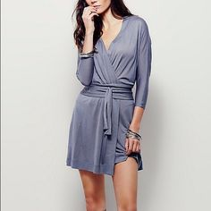 Nip/Free People/Tokyo Mini Dress/Wrap style mini Nip/Free People Tokyo Wrap Mini Dress/Made from FP semi-sheer Beach jersey, this effortless wrap dress features on-seam pockets and a waist tie. Throw on top of a bikini or layer over one of our seamless styles for an effortless look. This is a true wrap mini that is fully open and it only closes with the kimono style wrap belt/you can wear as a mini dress/tunic/or cover-up/color is called charcoal but it carries a light lavender tone to…