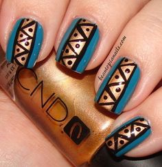 So easy to do,yet the effect is totally edgy and glam. Simply add a base coat of polish than paint a different color polish stripe down the middle. Add the black pattern on the stripe with a nail art pen.
