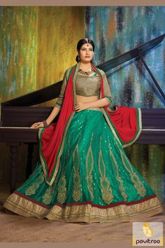 Create a dramatic canvas after attiring this extra chic looking green and red net designer bridal lehenga choli. It is beautiful with embroidery and butti.#lehengacholi, #chaniyacholi, #ghagracholi, #garbacholi, #weddingbrodalcholi, #navratricholi, #lehengastyle, #festivalcholi, #utsavfashion, #pavitraafashion,  http://www.pavitraa.in/store/lehengha-choli/