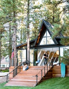 Two fun loving designers turn an A-frame cabin in the woods into a modern icon in the making. A Frame Cabin, A Frame House, Lake Cabins, Cabins And Cottages, Pergola, Cabin In The Woods, Kabine, Cabin Homes, Home Fashion